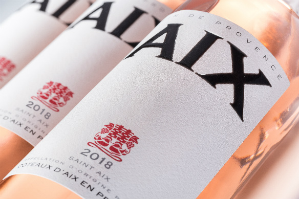 Aix rosé bottles lying in a row, taken up close showing the labels as the focal point