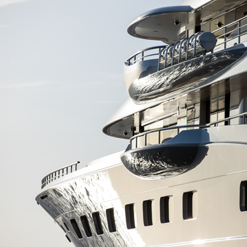 A side view of a luxury yacht exposed to the sun.