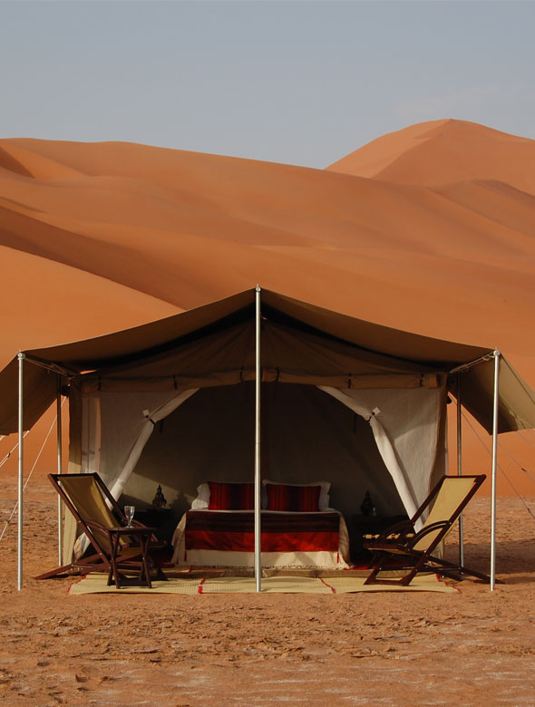 Sand dune tent with deck chairs and double bed