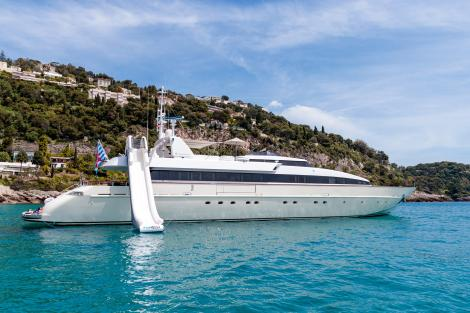 Motor yacht HEMILEA at anchor with inflatable slide
