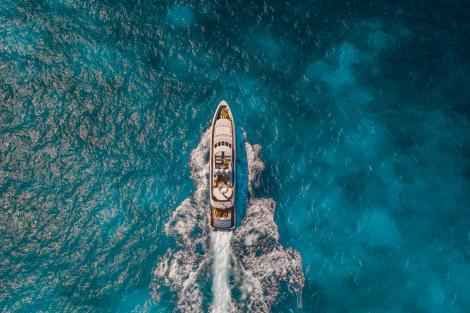 Aerial view of yacht cruising