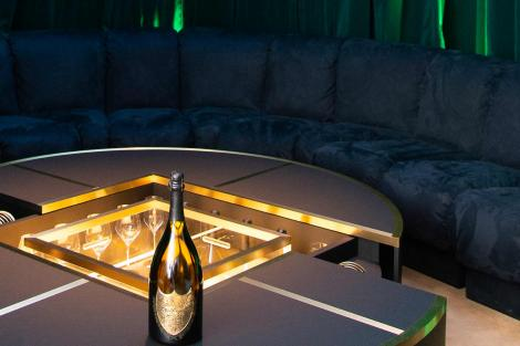Lenny Kravitz Champagne table with blue sofa