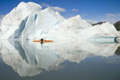 canoeing next to ice bergs