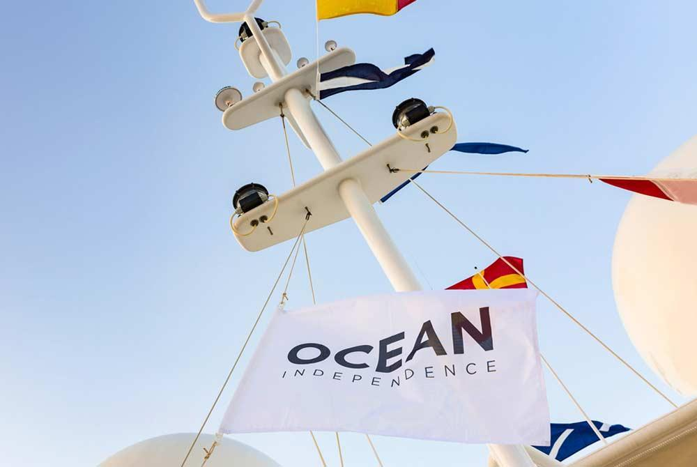An Ocean Independence flag hoisted up a mast